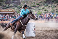 Cowgirl In Rodeo Action Stock Photos - 58493903