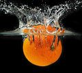 Splashing Orange Into A Water Royalty Free Stock Photo - 5850575