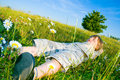 Child Lies On The Grass Stock Image - 5858441