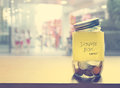 Donation Box, Coin In The Glass Bottle, Vintage Color Tone Royalty Free Stock Photo - 58505985