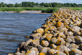 Ainazi North Pier Stones Covered By Yellow Moss Royalty Free Stock Image - 58507766