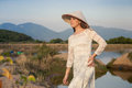 Blonde Girl In Vietnamese Dress Smiles Against Country Lakes Royalty Free Stock Photography - 58546847