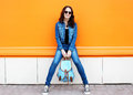 Stylish Pretty Young Woman Wearing A Sunglasses And Jeans Royalty Free Stock Images - 58558609
