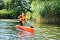 The Boy Rowing In A Canoe On The River. Royalty Free Stock Photography - 58570317