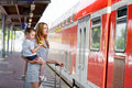 Cute Little Girl And Mother On A Railway Station. Stock Images - 58570984