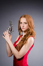 Pretty Young Girl In Red Dress With Gun Isolated Royalty Free Stock Photos - 58599218