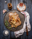 Grilled Meat With Spices On An Iron Baking Tray With A Napkin And Fork On A Rustic Wooden Background, Top View Stock Photo - 58625380