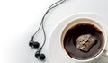 Close Up Cup Of Coffee With Earphone On White . Royalty Free Stock Photo - 58641685