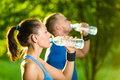 Man And Woman Drinking Water From Bottle After Royalty Free Stock Photo - 58671345