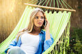 Beautiful Woman Talking On The Phone Outdoors Stock Images - 58684354