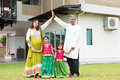 Asian Indian Family Outside Their New Home Royalty Free Stock Photo - 58687615