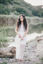 Beautiful Woman With Long Curly Hair Dressed In Boho Style Dress Posing Near Lake Royalty Free Stock Photography - 58696457