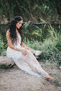 Beautiful Woman With Long Curly Hair Dressed In Boho Style Dress Posing Near Lake Royalty Free Stock Photos - 58696698