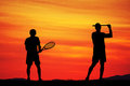 Tennis Players At Sunset Royalty Free Stock Image - 58703236