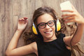 Child Listening To Music Royalty Free Stock Image - 58714686