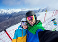 Couple Snowboarders Doing Selfie On Camera Stock Image - 58722041