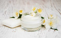 Face And Body Cream Moisturizers With Jasmine Flowers On White Royalty Free Stock Photography - 58723487