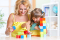 Child And Mom Playing Wooden Toys At Home Royalty Free Stock Image - 58748996