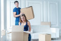Moving Home And Repair Of A New Life. Couple In Love Pulls Thing Stock Image - 58750201