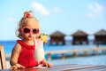 Cute Little Girl Drinking Cocktail On Tropical Stock Image - 58755161