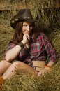 Cowgirl Sitting On Hay In The Stable Stock Photos - 58759123