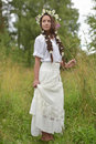 Girl With Braids And A Wreath Of Daisies Royalty Free Stock Image - 58760056