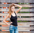 Portrait Of Trendy Sexy Girl Standing At The Old Wooden Wall Background. Urban Fashion Concept. Copy Space. Royalty Free Stock Images - 58764169