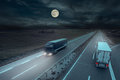 Blue And White Truck In Motion Blur At Midnight Stock Photo - 58788620