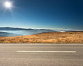 Side View Of Empty Highway In Mountain Range Royalty Free Stock Photo - 58789355