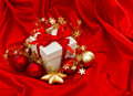 White Gift Box With Christmas Decoration. Red Gold Baubles Stars Royalty Free Stock Images - 58824949