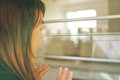 Woman Looking Out Window Stock Images - 58830204