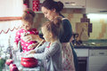 Mother With Kids At The Kitchen Stock Images - 58858414