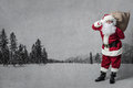 Santa Claus With A Bag Full Of Presents Stock Photography - 58864382