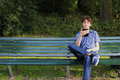 A Man Reading An E-reader On A Bench Stock Images - 58893904
