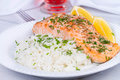 Steamed Salmon With Fresh Herbs And Lemon. Rice As A Garnish. Royalty Free Stock Photo - 58911935