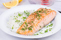 Steamed Salmon With Fresh Herbs And Lemon. Rice As A Garnish. Royalty Free Stock Photography - 58912077