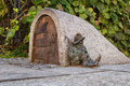 Dwarf Guards The Entrance Of A Small Building Royalty Free Stock Images - 58923439