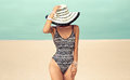 Glamorous Lady In Fashionable Swimsuit And Beach Accessories Hat Royalty Free Stock Image - 58943586