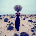 Fashion Photo. Girl In The Desert With A Bouquet Dead Branches Stock Photography - 58944292