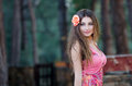 Smiling Young Lady With Attached Flower In Hair Stock Image - 58954061