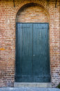 Green Doors In Brick Archway Stock Photography - 58954162