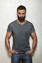 Bearded Brutal Guy Wearing Blank Grey T-shirt Royalty Free Stock Photography - 58969767
