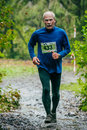 Old Man Running Uphill Royalty Free Stock Images - 58971149