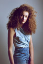 Teen Female Fashion Model With Curly Hairstyle In Denim Shirt Stock Photo - 58971670