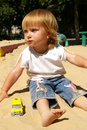 Girl Plays Sand On A Beach Royalty Free Stock Image - 5908106
