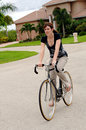 Young Woman Riding A Bike Stock Images - 5909164