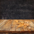 Autumn Background Of Fallen Leaves Over Wooden Table And Blackboard Backgrond With Room For Text Royalty Free Stock Photo - 59010465