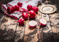 Fresh Organic Radish With Salt On Rustic Kitchen Table. Simple Food Royalty Free Stock Images - 59012389