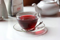 Transparent Glass Cup Of Red Fruit Tea On The Stock Image - 59013851