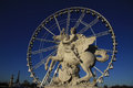 Statue Of King Of Fame Riding Pegasus On The Place De La Concorde With Ferris Wheel At Background, Paris, France Stock Photography - 59020022